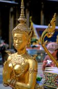 Travel photography:Golden Kinnara figure at Wat Phra Kaew in Bangkok, Thailand