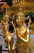 Travel photography:Golden Kinnara figures at Wat Phra Kaew in Bangkok, Thailand