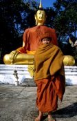 Travel photography:Monk with giant Buddha near Chiang Rai, Thailand