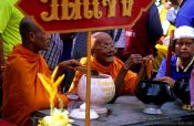 Travel photography:Monk blessing with water at a festival in Trang, Thailand