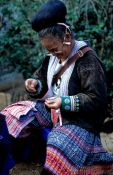 Travel photography:Mhong woman sewing, Chiang Rai province, Thailand
