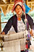 Travel photography:Woman with her loom at the Ban Lorcha Akha village, Thailand