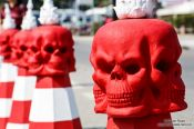 Travel photography:Red skulls on traffic cones at the Chiang Rai Silver Temple, Thailand