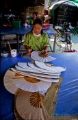 Travel photography:Woman making hand fans at the Bo Sang parasol factory, Thailand