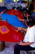 Travel photography:Painting parasols at the Bo Sang parasol factory, Thailand