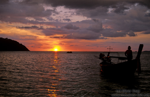 Sunset with Chao Leh longtail boat in Ko Tarutao Ntl Park