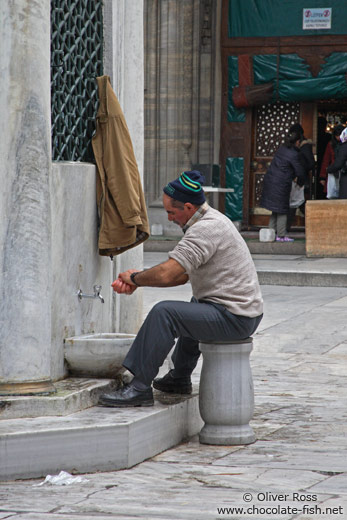 Ritual cleansing before the Friday prayer outside Yeni Mosque in Istanbul