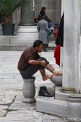 Travel photography:Ritual cleansing before the Friday prayer outside Yeni Mosque in Istanbul, Turkey