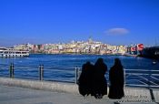 Travel photography:Three women in burkas enjoy the view across the Golden Horn, Turkey
