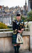 Travel photography:Edinburgh man playing the bagpipes, United Kingdom