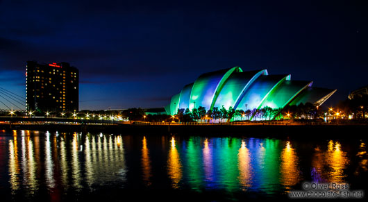 The Glasgow Clyde Auditorium with Bell`s Bridge illuminated by night