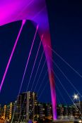 Travel photography:The Glasgow Clyde Arc illuminated at night , United Kingdom