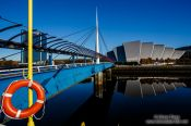 Travel photography:The Clyde Auditorium with Bell`s Bridge across the River Clyde in Glasgow, United Kingdom