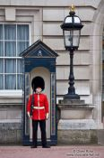 Travel photography:Guard outside Buckingham Palace in London, United Kingdom, England