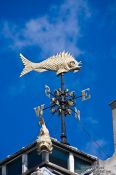 Travel photography:Golden fish weather vane in London, United Kingdom, England