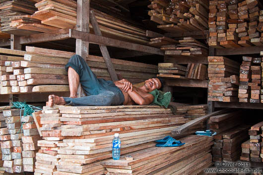 Man sleeping in a wood shop in Danang
