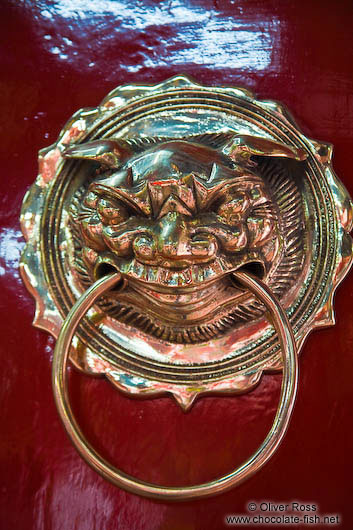 Brass door knob at a Chinese assembly hall in Hoi An