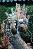 Travel photography:Dragon sculpture in a Chinese assembly hall in Hoi An, Vietnam