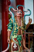 Travel photography:Figure at a Hoi An Chinese assembly hall , Vietnam