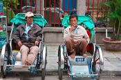 Travel photography:Hoi An ricksha drivers waiting for customers, Vietnam