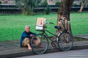 Travel photography:Hue woman with bike, Vietnam