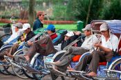 Travel photography:Hue ricksha drivers waiting for customers, Vietnam