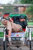 Travel photography:Hue ricksha driver having a nap, Vietnam