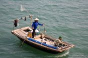 Travel photography:Fishing boat in Halong Bay , Vietnam