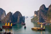 Travel photography:Junk ships cruising through Halong Bay , Vietnam
