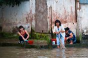Travel photography:Women doing their laundry in the river at Can Tho , Vietnam