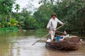 Travel photography:Floating merchant in a Mekong tributary near Can Tho , Vietnam