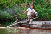 Travel photography:Boy driving a boat near Can Tho , Vietnam