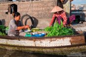 Travel photography:Selling vegetables at the Can Tho floating market , Vietnam