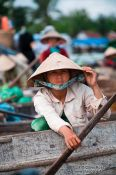 Travel photography:Woman at the Can Tho floating market , Vietnam