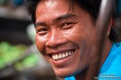 Travel photography:Happy food vendor at the Can Tho floating market , Vietnam