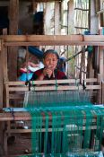 Travel photography:Woman weaving in a village near Chau Doc , Vietnam