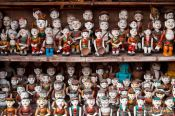 Travel photography:Small figures inside Hanoi´s Temple of Literature , Vietnam