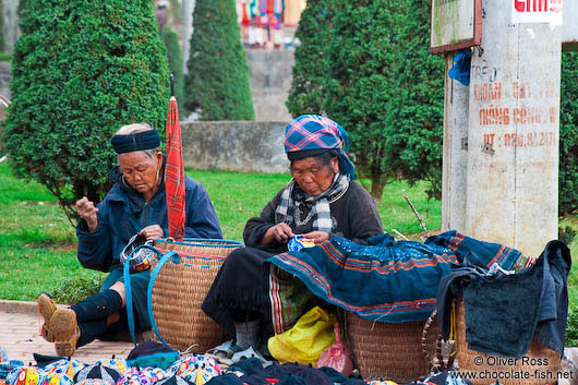 Hmong women sewing clothes in Sapa
