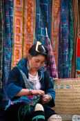 Travel photography:Hmong girl sewing in Sapa , Vietnam