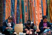 Travel photography:Hmong girls doing handy work in Sapa, Vietnam