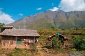 Travel photography:Houses near Sapa with Fansipan mountain in the background, Vietnam