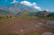 Travel photography:Rice fields near Sapa with Fansipan mountain in the background, Vietnam