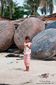 Travel photography:Girl in front of the round boats typical for Mui Ne , Vietnam
