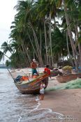 Travel photography:Fisherman preparing the net at Mui Ne , Vietnam