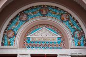 Travel photography:Detail above the entrance portal to the Hoh Chi Minh City Municipal Theatre , Vietnam