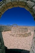 Travel photography:Stone arch and podium on hill near San Pedro de Atacama, Chile
